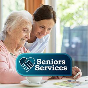 health professional assisting elderly resident with puzzle